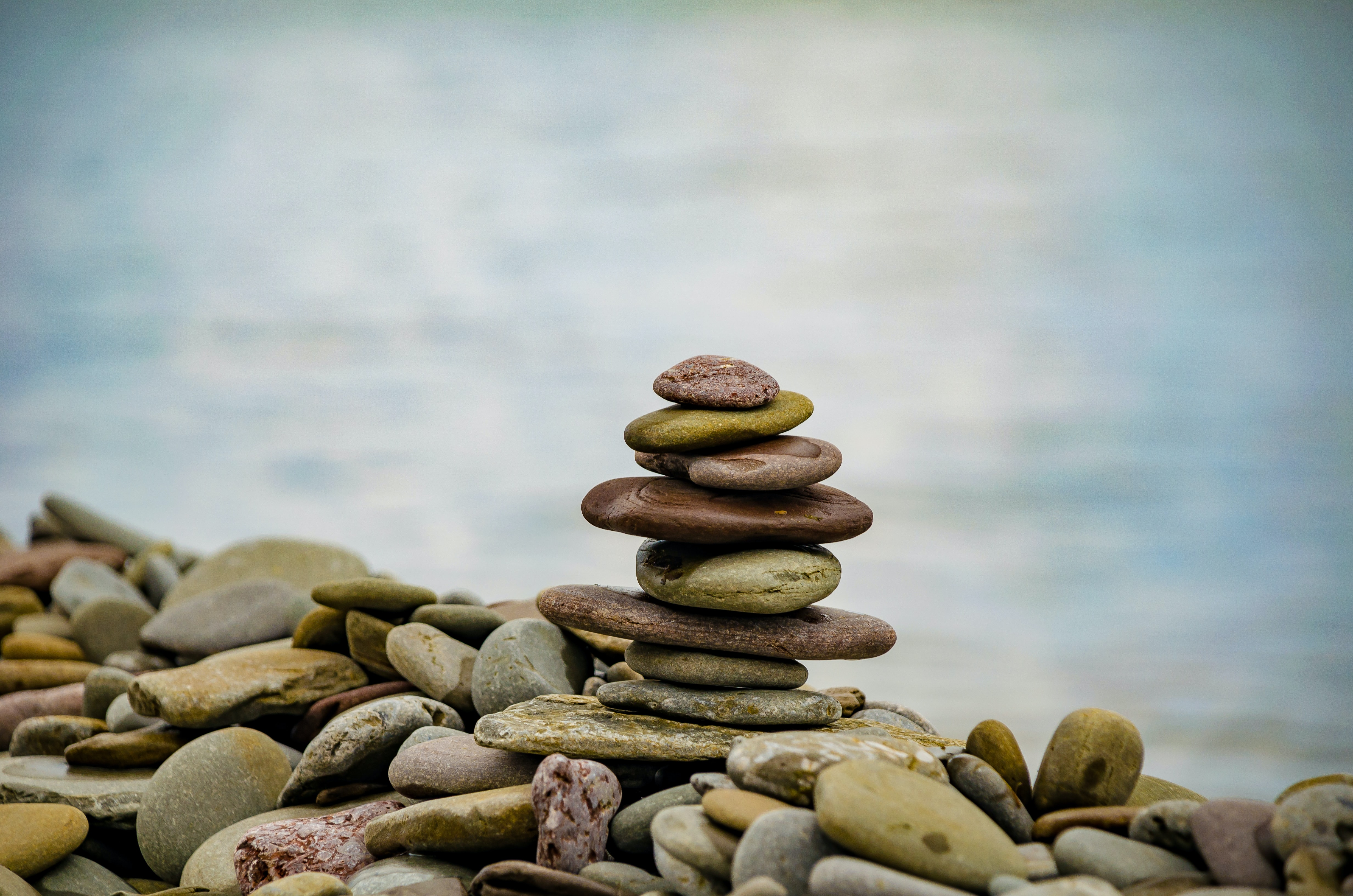 rocks stacked and balanced on beach