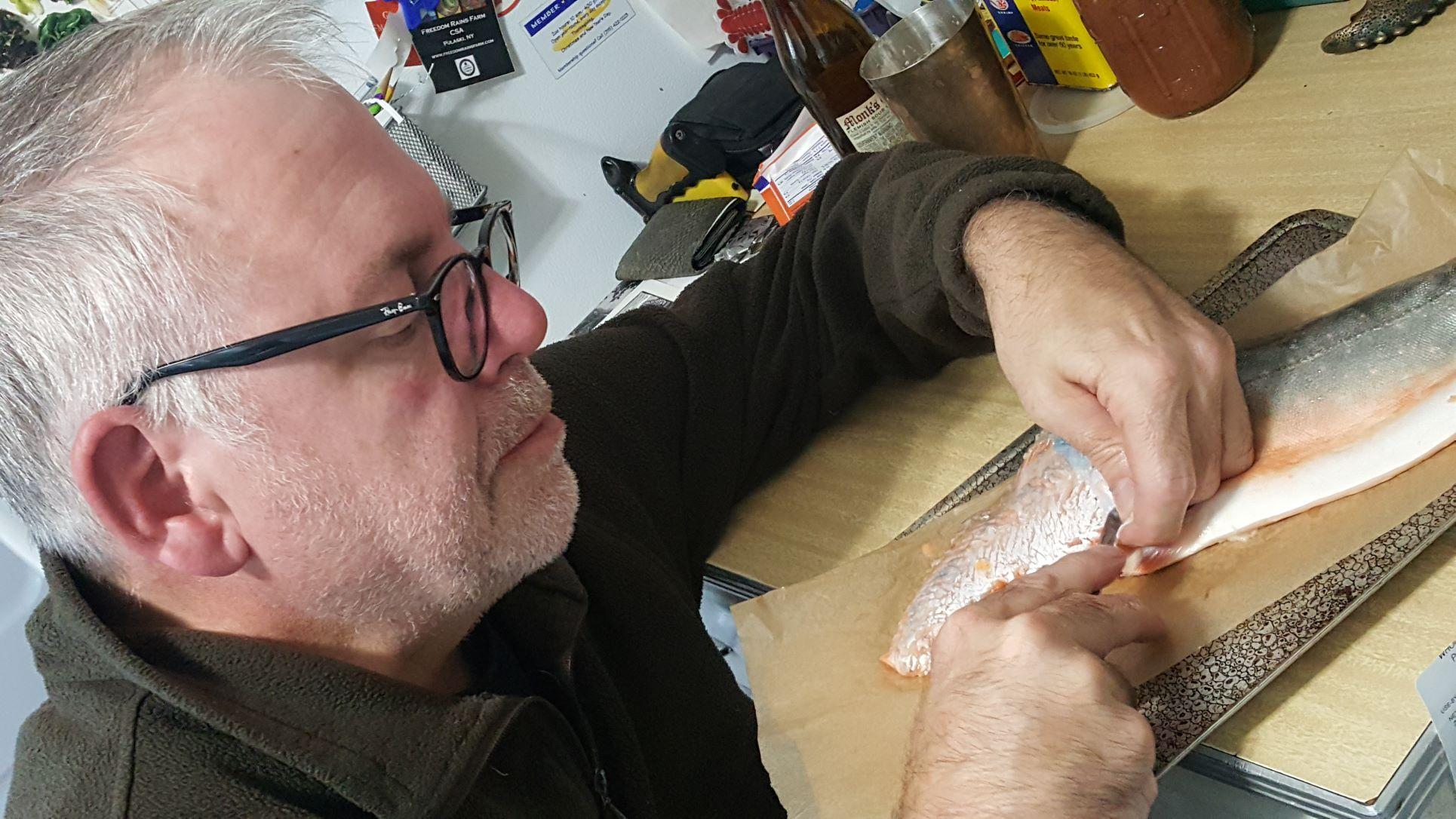 Peter Verheyen works on a bookbinding project.