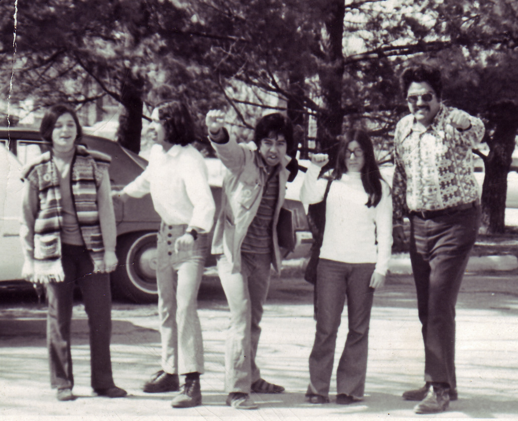 A black and white photograph of 5 students in the 1970s.