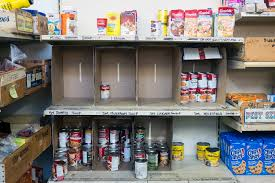 Cans on shelf at food pantry