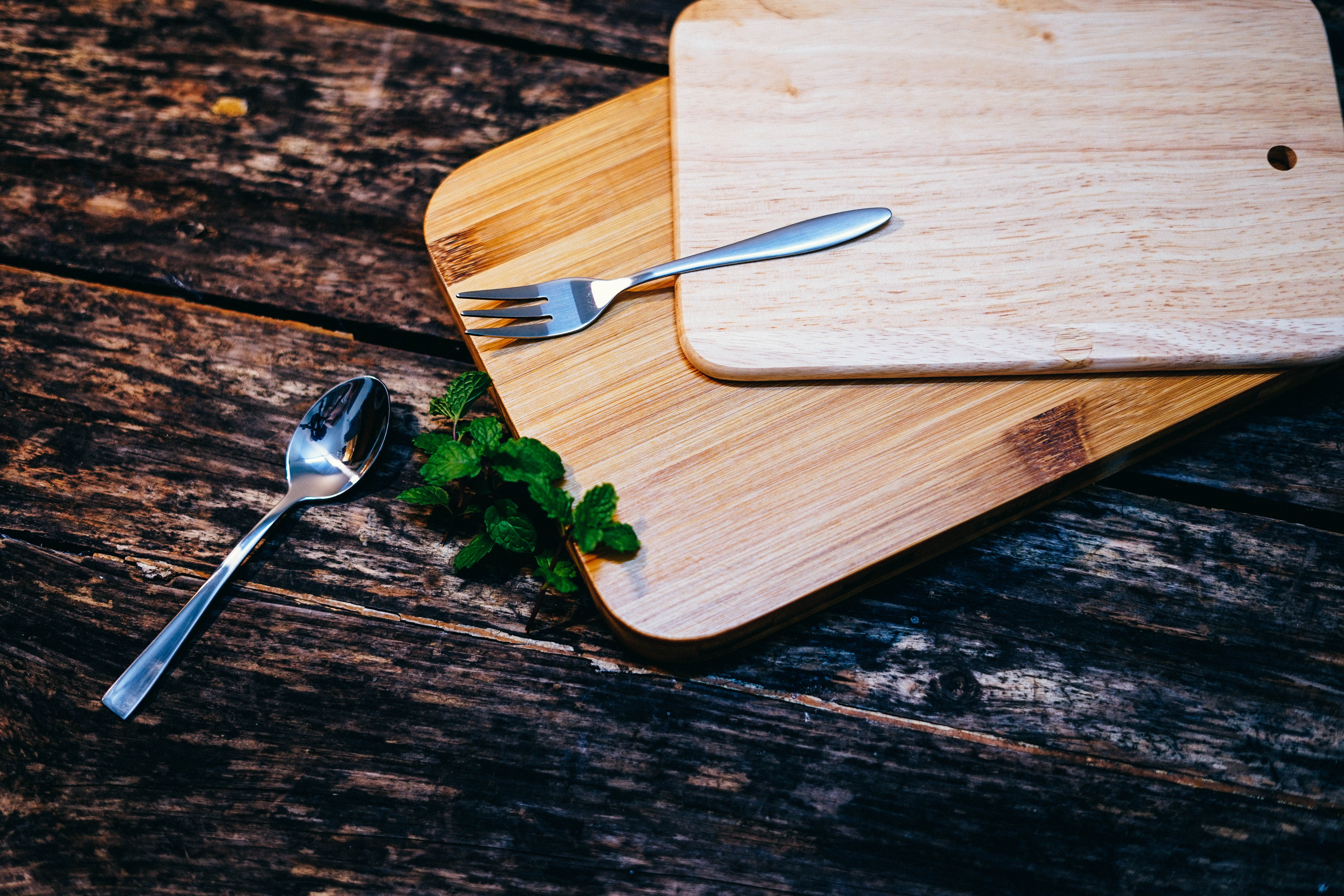 fork and spoon on bamboo cutting boards