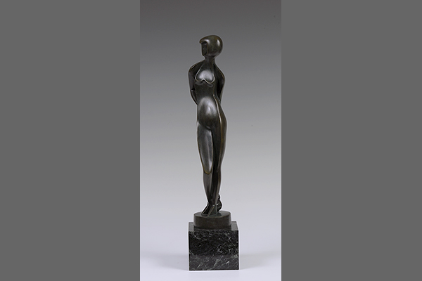 Sculpture of a human body rendered abstractly in bronze.