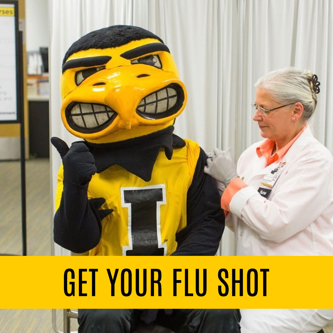 image of Herky getting a flu shot