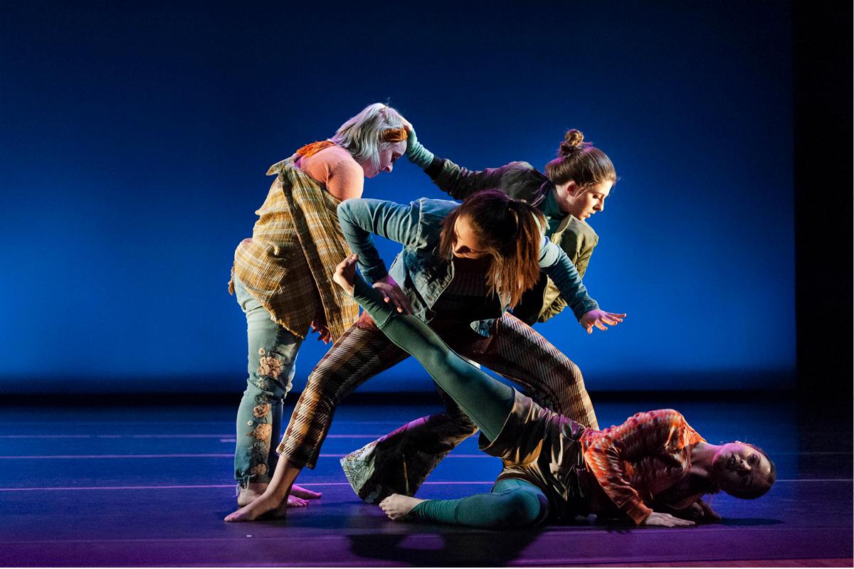 Graduate/Undergraduate Concert image. Group of four dancers.