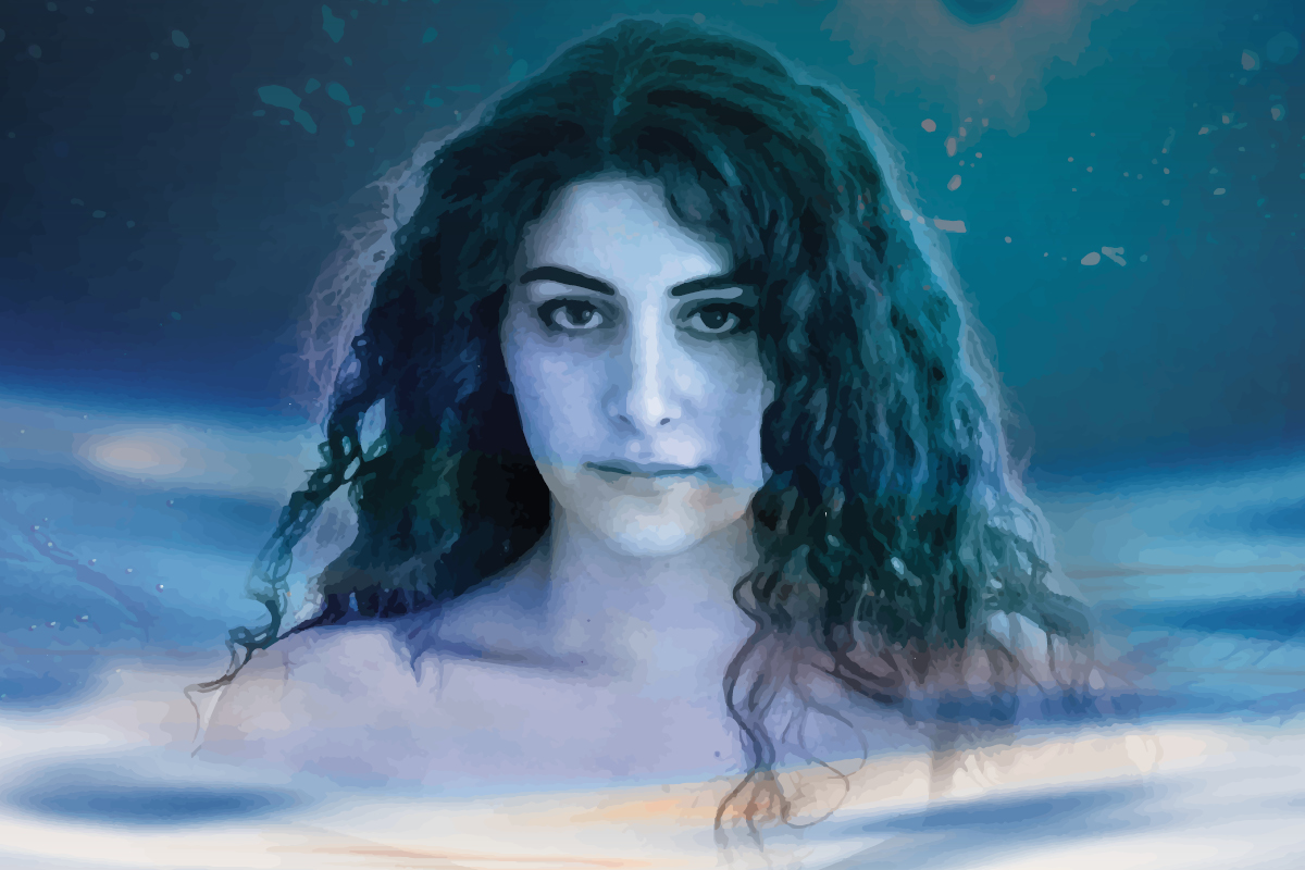 Iphigenia Point Blank poster image. Woman with long curly hair, in the water, looking at viewer.