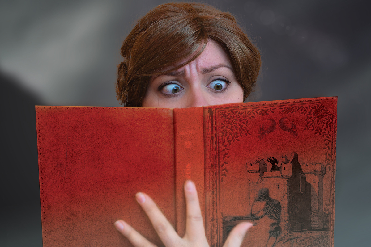 Northanger Abbey poster design. Actress with shocked look on her face, reading a book.