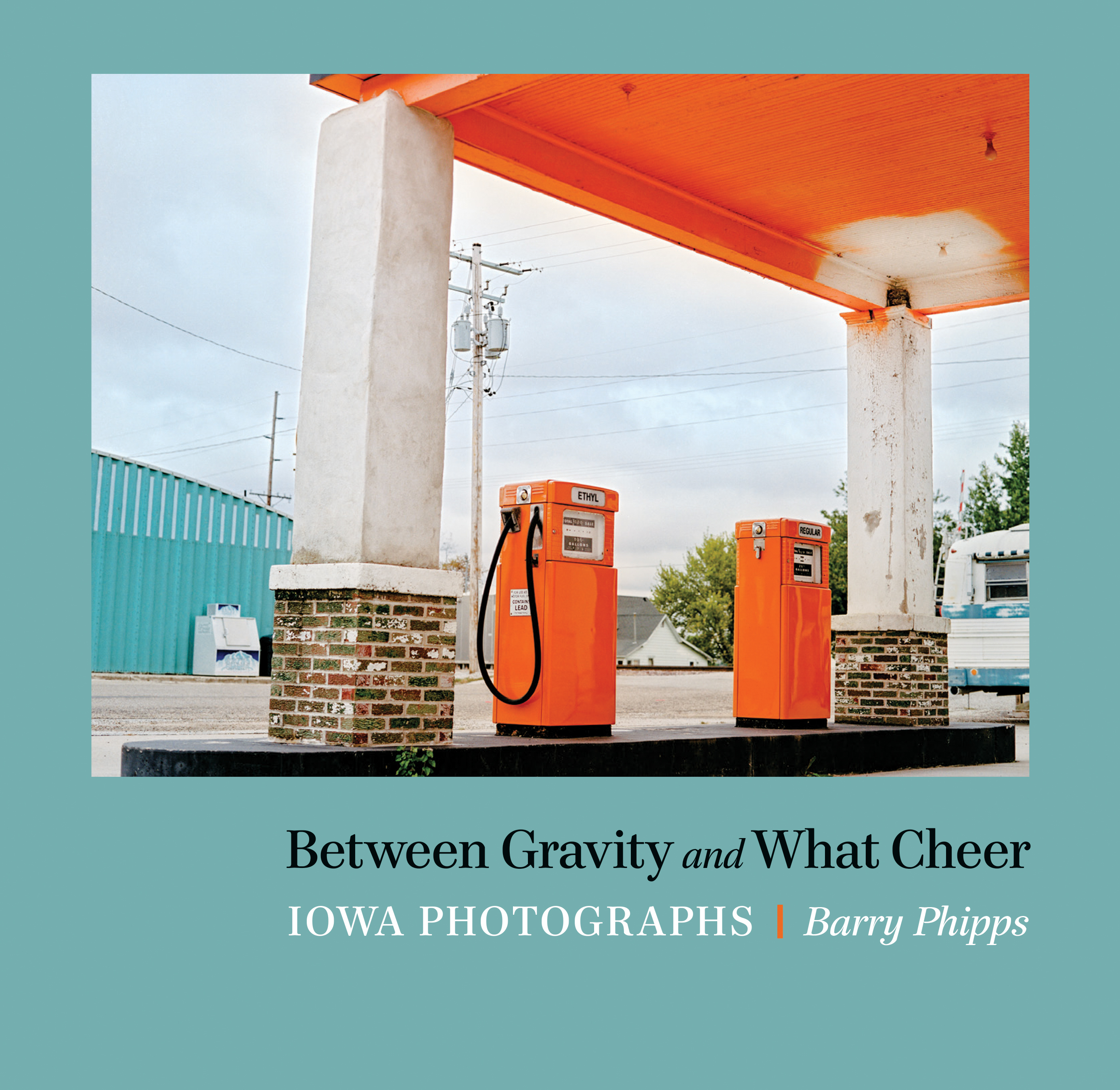 Photograph of orange gas pumps at a gas station by Barry Phipps from Between Gravity and What Cheer Iowa Photographs