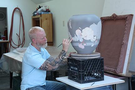 Dirk Staschke working on glazing a ceramic pot